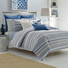 The Sedgemoor Duvet Cover Set features a soothing yarn-dye stripe in cool grey, chambray, and royal blues, all rounded off with stylish accents of ivory.