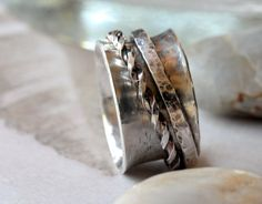 still a favorite, all time best seller.....Hammered Artisan Sterling Silver Spinner ring...made by 11thHouse, $95.00