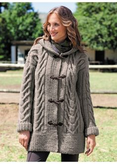 This hooded coat is knitted with Duvetine yarn. Large structured cables accentuate the silhouette. The wide, ribbed edges and hood are knitted in beaded rib. The coat is fastened using 4 toggle and loop fastenings in faux suede. It is knitted using a Hooded Cardigan, Cardigan Pattern, Jacket Pattern, Long Cardigan, Knitting Patterns Free, Free Knitting, Free Pattern, Sewing Patterns, Vogue Patterns