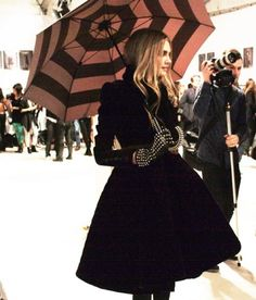Black coat with stylish leather gloves