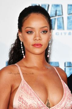Make like Rihanna and try a simple slicked back, low half-up.