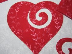 Learn the basics of raw edge machine appliqué while making a sweet swirly heart in this I ♥ Applique tutorial.
