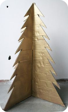 how to make a cardboard xmas tree: love it! You could get so creative with this idea! Bows, garland, paint it green and hang one ornament for a Charlie Brown tree, write out The Christmas Story in pretty handwriting, use stickers. Charlie Brown Christmas Tree, Real Christmas Tree, Christmas Tree Painting, Christmas Holidays, Charlie Brown Christmas Decorations, Whoville Christmas, Christmas Service, Christmas Houses, Xmas Trees