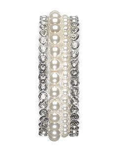 Set van vier armbanden van het merk Abrazi. Deze handgemaakte, zilverenset bestaat uit parels en swarovski. De armbanden zijn ook verkrijgbaar in rosé goud.