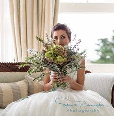 Styled Bridal shoot in a country house hotel in Devon, featuring bespoke wedding dress, wedding flowers, AMAZING Venue & fine art wedding photography by Stuart Brampton