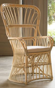 Masterful workmanship and the natural beauty of rattan make our Phoebe Outdoor Chair with Cushion not only a seat of distinction but a fabulous focal point.