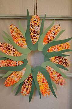 Thanksgiving wreath.  Print large paper with bubbles from packing wrap, cut out corn cob and husk, then glue to paper plate or cardboard ring.