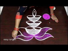 Rangoli is an art form, originating in the Indian subcontinent, in which patterns are created on the floor in living rooms or courtyards using materials such. Rangoli Designs Peacock, Rangoli Designs Latest, Colorful Rangoli Designs, Rangoli Designs Diwali, Happy Diwali Rangoli, Diya Rangoli, Rangoli Ideas, Indian Rangoli, Small Rangoli