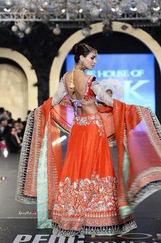 Orange lengha by House of Kamiar Rokni at PFDC Bridal Fashion Week 2013