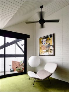 Love the brick wall, the paneled ceiling, the lampshade, the ceiling fan.