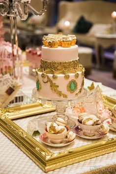 Cake Opera Co. #Pink and #gold mini cakes adorn this Marie Antoinette inspired dessert table  | WedLuxe Magazine #luxurywedding