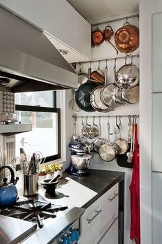 Small kitchen storage for pots and pans on the wall