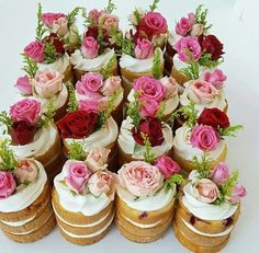 DIY Mini Layered Cakes filled with Cream Cheese Frosting + Topped with Prim/Mini Roses + (Could also add candies, like gummies or jelly beans.)