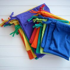 A rainbow of drawstring pouches - made from up-cycled tee shirt sleeves.