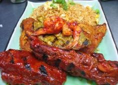 Mai Thai BBQ Special :Two pieces BBQ chicken, two pieces BBQ pork ribs, two pieces beef satay, and two BBQ shrimp. Served with egg fried rice and house salad  from Mai Thai Restaurant in Fountain Valley #Food #BBQ forked.com