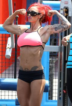 She shocked fans when she entered a bodybuilding competition back in October and it seems Jodie Marsh isn't over her latest career move yet. The 33-year-old glamour model became interested in bodybuilding back in 2009 was spotted filming scenes for her new show on Discovery Channel at Muscle Beach in Los Angeles. Her bright red hair was pulled up in a messy style, and the skimpy outfit highlighted her various tattoos. via dailymail.co.uk