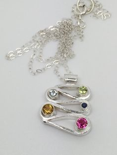 Sterling silver switchback pendant with gemstones