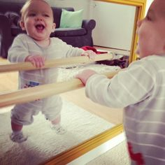 install a railing onto or next to a long mirror when baby starts to pull himself up and can walk along it eventually.