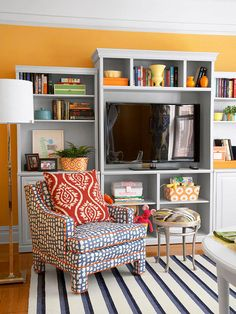 We love the bright colors and chic patterns in this family room. See more inspiring spaces: http://www.bhg.com/rooms/living-room/family/cozy-family-room-decorating/#page=1
