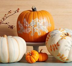 Stencil leaf patterns on to pumpkins for easy and elegant fall decorating. Autumn crafts. Outdoor decor. Country cottage style.