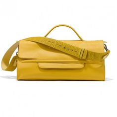 Soft but resistant calfskin daily bag, NINA introduces a new way to wear the bag: tight to your body.