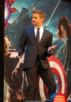 Haha I like how the picture of the Black Widow in the background looks like she's watching him.
