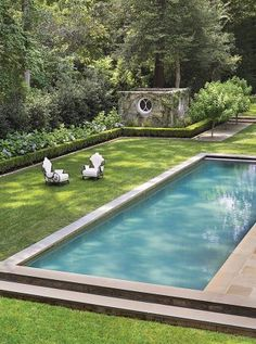 Traditional Pool by Suzanne Kasler Interiors and William T. Baker Associates Ltd. in Atlanta, Georgia
