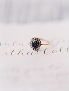 Sapphire engagement ring: http://www.stylemepretty.com/2016/08/04/elegant-modern-white-wedding-inspiration/ | Photography: Sara Weir - http://www.saraweirphoto.com/