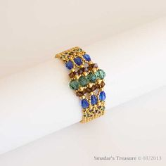 Gold Beaded Bracelet with Sparkling Swarovski Crystals in Sapphire Blue, Emerald Green and Smoked Dark Topaz. Art Deco Geometric Style