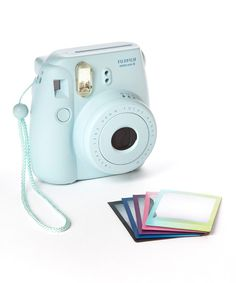 Love mine! So much fun to hold your photos in your hand instantly. :: Blue Instax Mini 8 Camera & Film Set