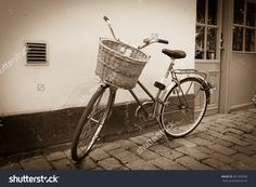 http://www.shutterstock.com/pic-201769358/stock-photo-classic-vintage-retro-city-bicycle-in-stockholm-sweden.html?src=z1Js5wc…