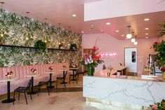 San Diego's Holy Matcha is decorated in tropical green and pink, with marble and brass accents. Design by Homework, photo by Stacey Keck.