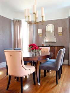 Soft lavender gray and pink tones give the dining room a dreamy, romantic vibe. The brass chandelier adds a mix of midcentury modern and traditional elegance. Design: Jennifer Jones, Niche Interiors