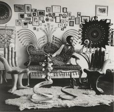 "Surrealist designer Pedro Friedeberg with his ""hand chair"", photographed by Kati Horna, 1966."
