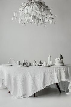 Claire Delmar for The Grace Tales | Fritz Hansen Drop Chair, HAY Paper Porcelain Cups and Saucers