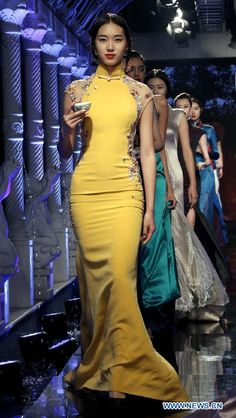 """Models present creations during """"Basic Chi-pao show"""" in Beijing, China, May 16, 2015 http://www.chinaentertainmentnews.com/2015/05/chi-pao-show-kicks-off-in-beijing.html"""