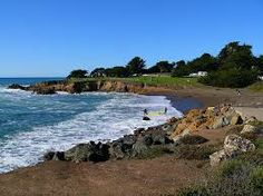 Cambria, California  My favorite little go-to place on the California coast (8 miles south of Hearst Castle - San Simeon, CA). And a 2-hour (or so) drive to Carmel, CA. I find this to be a blissful vacation.  This picture is across the street from some amazing bed-and-breakfast spots on Moonstone Beach Drive :))