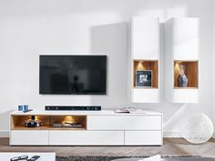 White tv unit modern wall storage system in matt white unit 2 wall cabinets white wooden . Tv Wall Decor, White Tv Unit, Wall Cabinet, Wall Storage Systems, Wall Unit, Room, Modern Shelving, Room Design, Tv Wall Unit