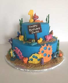 Finding Nemo birthday cake - buttercream iced cake with modeling chocolate details. Plastic Nemo characters added