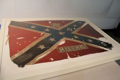This is a rare 65th Georgia Infantry flag carried during the Atlanta campaign, complete with 41 bullet holes and blood stains. The 1864 Civil War banner has been fully restored.  The 1864 banner had been held by the Davis family of Alabama for nearly a century and a half after Private John Davis of the 65th Georgia Regiment rolled it up, tucked it in his boot and brought it home at the end of the Civil War.