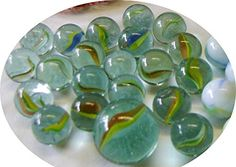 Decorative Clear Glass Marbles in netted bag - 20+1 Dobber (Shooter Marble) Cat Eye Marbles Decorative Glass Marbles http://www.amazon.co.uk/dp/B012H8FEMG/ref=cm_sw_r_pi_dp_urPpwb14632G6