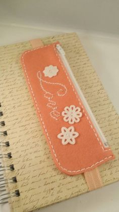 Check out this item in my Etsy shop https://www.etsy.com/listing/248274079/love-stitched-pen-and-pencil-bookmark