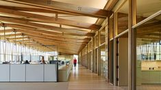Graham Baba Architects took cues from rural vernacular architecture while conceiving the headquarters for the Washington Fruit and Produce Company. Seattle Architecture, Timber Architecture, Vernacular Architecture, Architecture Design, Timber Buildings, Office Buildings, Fruit Company, Wooden Barn, Cove Lighting