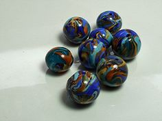 2 Mixed lots of 8 Polymer Clay Beads Swirling Blue, White and Gold and Purple, Gold by OrdinaryWomen on Etsy