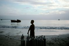 Alex Webb  NICARAGUA. Corn Island. 2003. Tanks and a child at the end of the day, after diving.
