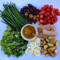|| N I C O I S E   S A L A D ||  - 1 head Romaine chopped - 1 cup cherry tomatoes sliced n hlaf - 3 hard boiled eggs sliced - 1/2 pound baby potatoes - fresh olives - haricort verts - Tuna in olive oil ( I recommend the jarred kind called Tonnino)   DRESSING - 2 teaspoons dijon mustard - juice of one lemon - 1 garlic clove minced - 1/4 cup olive oil - salt and pepper