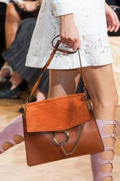 The 50 Best Bags for Spring 2015 | StyleCasterCHLOE: Chloé was another fashion house that sent bags down the runway inspired by the 1970s. This was a standout.   Read more: http://stylecaster.com/best-bags-spring-2015/#ixzz3FYqG7zl5