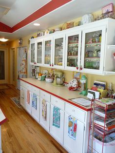 Tons of great ideas in this retro kitchen! Love the red trim!!