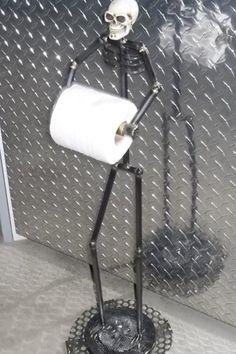 Man cave #skeleton toilet paper holder.