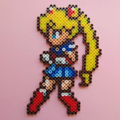 For Love and Justice, the pretty sailor suited soldier Sailor Moon! In the name of the moon I will punish you! This piece is inspired by the lovely and kawaii anime and manga character Sailor Moon, and has been handmade using high quality Hama/Perler brand fuse beads in her traditional colours. Perfect as a little decoration item! This pixel art piece could be added to a picture frame, pinned on a wall or door, or even used as a coaster/mat, and would be a fun addition to any Sailor Moon…